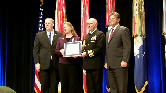 Dr. Mary Ann Spott is presented the Distinguished Civilian Service Award