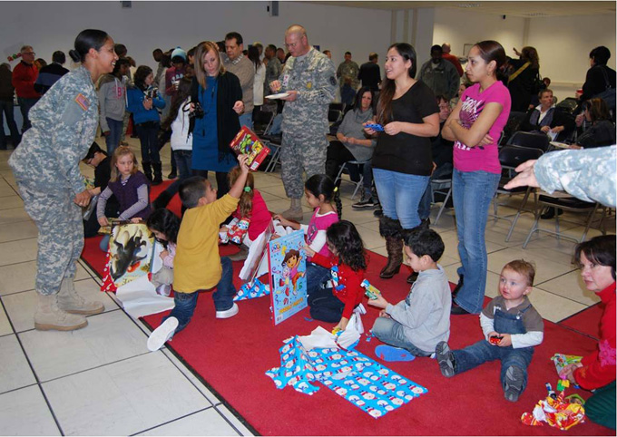 Children at the U.S. Army Medical Materiel Center, Europe receive presents from Soldiers and staff members