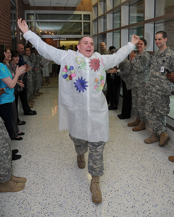 Spc. Shawn Lackey models a decorated lab coat