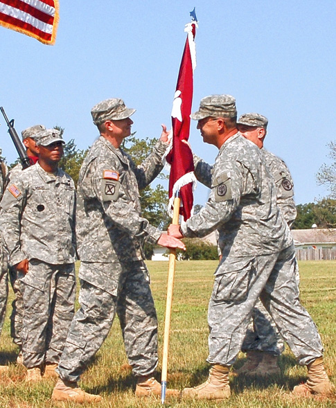 Col. Bruce A. Schoneboom receives the unit flag from Maj. Gen. James Gilman