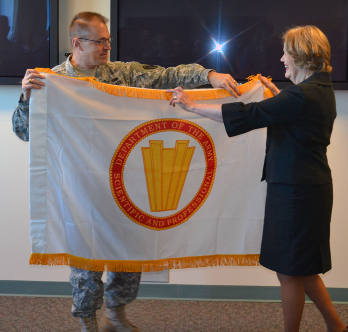 Maj. Gen. Brian C. Lein presented Dr. Marti Jett with the Department of the Army Scientific and Professional Senior Executive Service flag