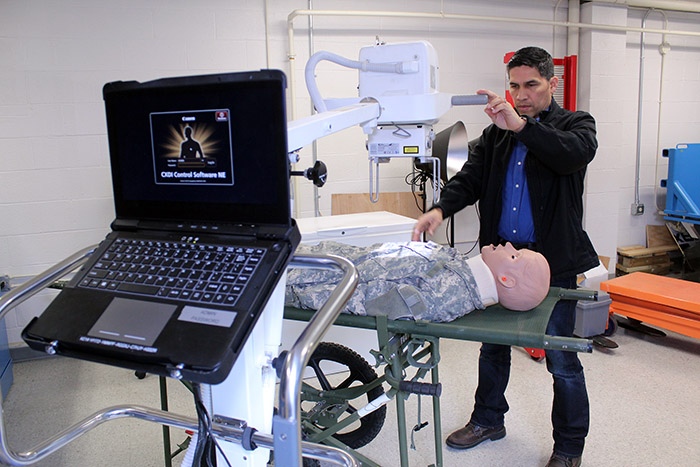 Diego Gomez-Morales demonstrates the new Portable Digital Radiography System