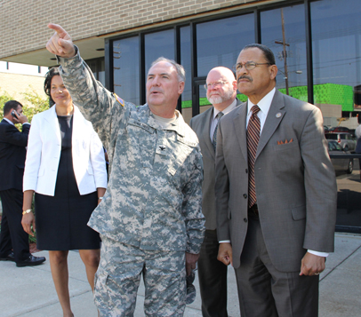 Col. Peter Schultheiss discusses construction progress with Rep. Sanford D. Bishop Jr.
