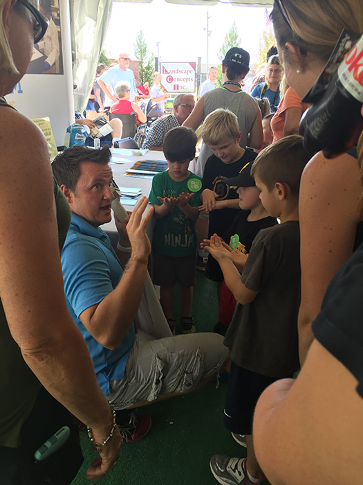 Michael Sandridge speaks with kids at the Great Frederick Fair