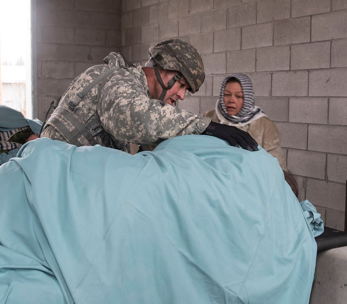 Sgt. 1st Class Ilker Irmak tends to a victim