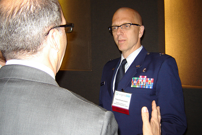 Col. Todd Rasmussen in conversation during the 2015 THRiVE bioscience conference on April 23, 2015