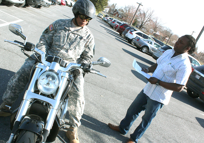 Wendell Johnson completes a motorcycle safety inspection with Greg Pugh