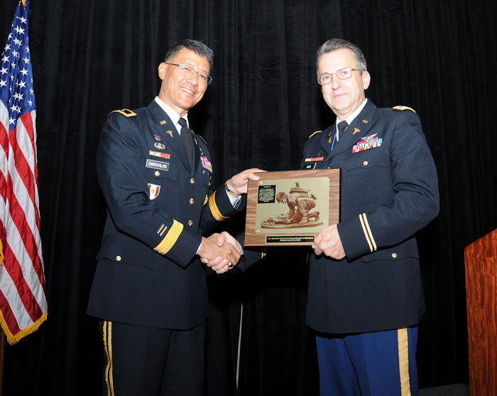 Combat Casualty Care Research Program Director Col. Dallas Hack received a plaque at the Military Health System Research Symposium