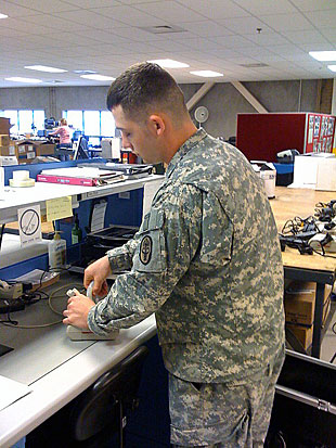 Spc. Bryan J. Posey, 68A, Biomedical Equipment specialist stationed in Utah reviews the Simplified Automated Ventilator