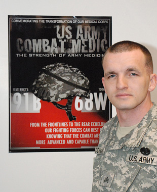 Sgt. Christopher Giddinge of the U.S. Army Medical Research Institute of Infectious Diseases stands by his winning poster